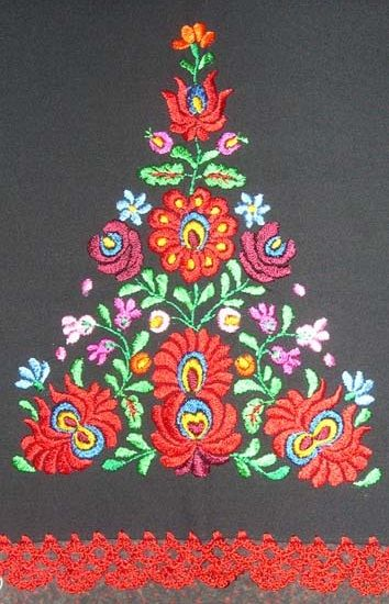 Detail of table runner from Mezokovesd, Hungary. Matyo embroidery on black fabric.
