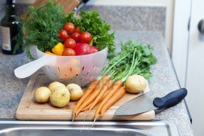 http://www.123rf.com/photo_10483554_vegetables-and-herbs-on-a-cutting-board.html