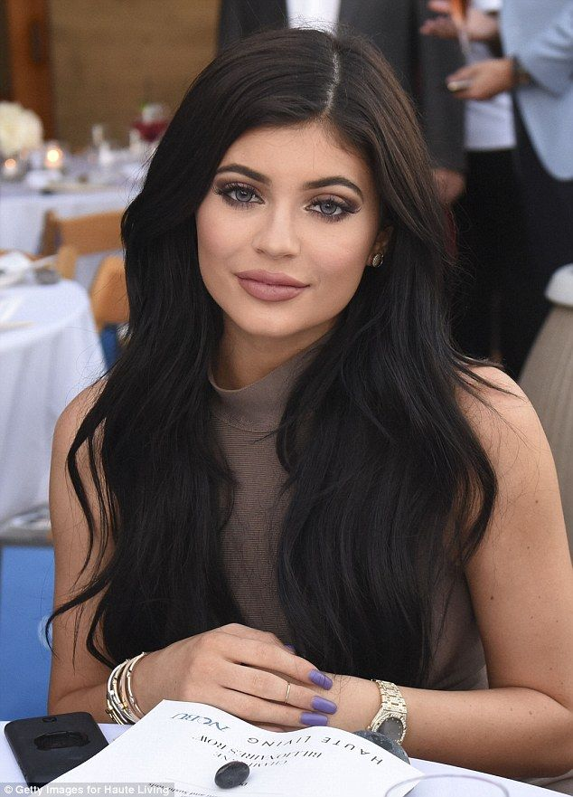 Kylie Jenner squeezes into skin-tight mini-dress for family dinner #dailymail