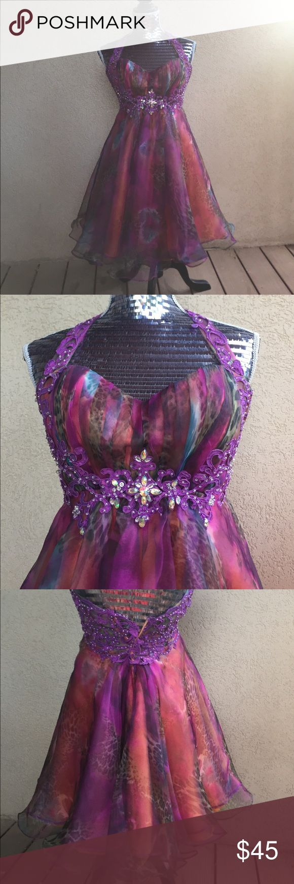 Multi color prom dress Lots of different colors going on in this dress, gems stones and lace sewn in Dresses Prom