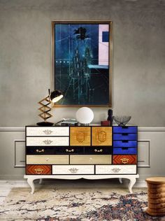 Home decor ideas for entryway - world. Drawers that count different and varied techniques from glass to wood, lacquer color to mirror and gold leaf compose this contemporary sideboard, finely refined by brass handles