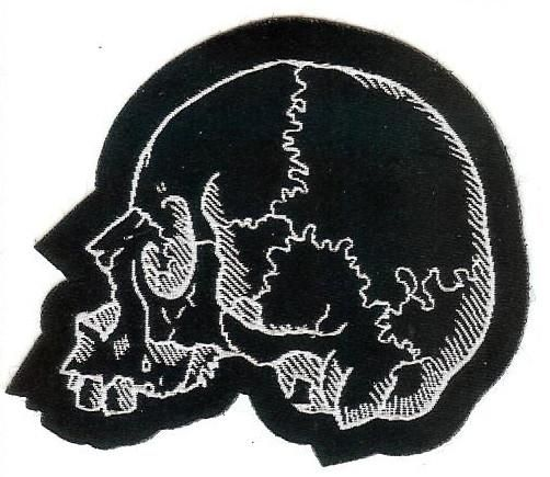 Left facing, cut out skull patch for sewing onto garments and accessories. Great for Halloween crafts.