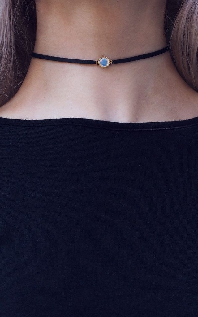 A moonstone leather choker in gold is the perfect finishing touch to any outfit.