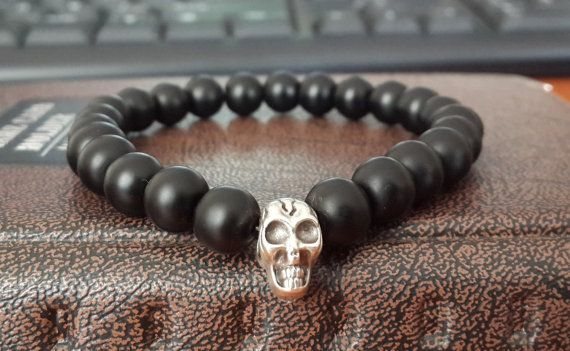Hey, I found this really awesome Etsy listing at https://www.etsy.com/listing/217420579/mens-silver-skull-bracelet-matte-onyx