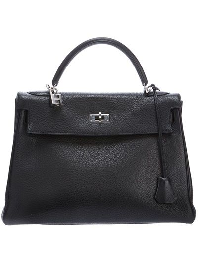 Hermès Vintage Kelly Bag from A.N.G.E.L.O.. Black Taurillon Clemence leather 'Kelly' bag from Hermès featuring a small front flap closure with a silver-tone twist lock fastening, expandable side panels with strap fastenings, a curved top handle with a hanging leather fob and silver-tone logo embossed padlock, a detachable shoulder strap and an interior zip fastening pocket. Height 32cm.