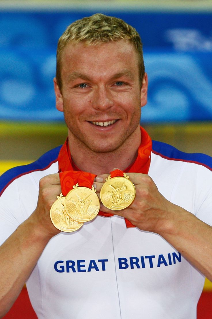 Chris Hoy celebrating his three gold medals in cycling at the 2008 Beijing Olympic games
