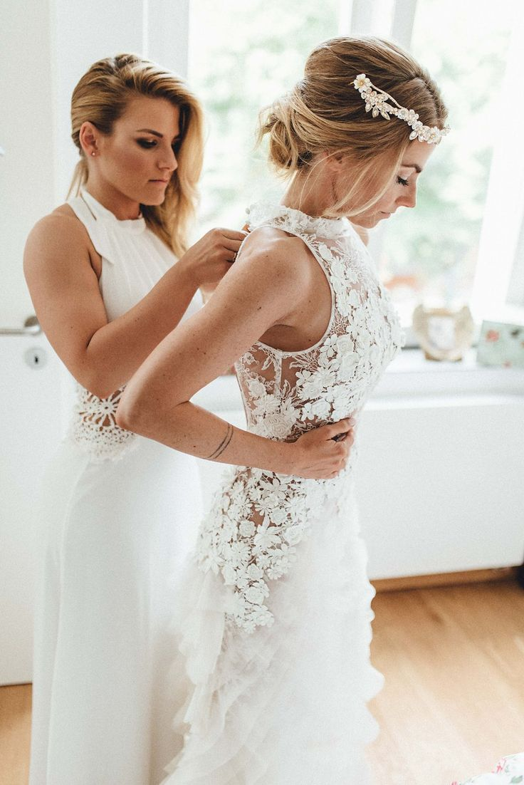 This elegant boho biergarten wedding has seriously chic bridal style, a beautiful German venue, and tons of love in the air.