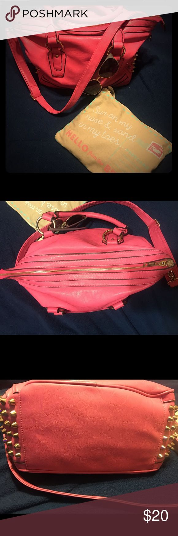 ⚡️⚡️ SUMMER BAG ALERT 🚨⚡️⚡️ Super chic hot pink purse with gold dull ended spikes on either side 🔱 comes with long adjustable strap.  This bag is PERFECT for spring & summer time!  Has some signs of wear on one of the short handles (pictured above) and has normal wear inside bc it was pre-loved ❤️ the inside zipper pocket doesn't have the tab you hold onto to zip/unzip, but it still zips up just fine.  Idk if it's real leather 😕 feel free to make reasonable offers 🙏🏽🎯 mms Bags Satchels