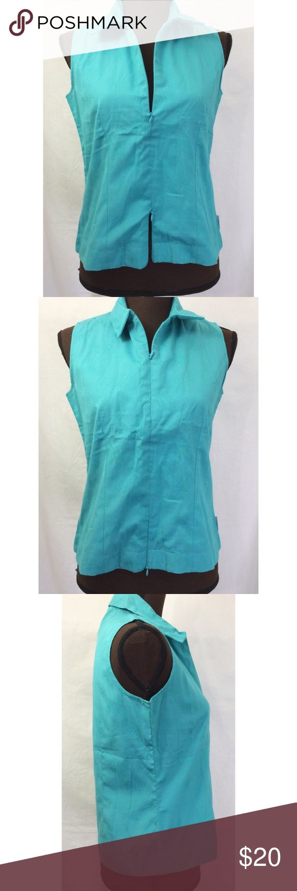 Women's Woolrich Sleeveless Top Women's Woolrich Sleeveless Top. Color Teal. Has floral pattern on it. Zips up at the top and the bottom separately. See pictures. Armpit to armpit 18 inches. Length 22 inches. Size Small. Woolrich Tops