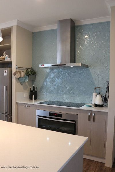 Pressed metal splashback - Perth. This is the Bluebells design and you can learn more about it here: http://www.heritageceilings.com.au/tempat/bluebells.php  A low cost way to create a divine splash back.