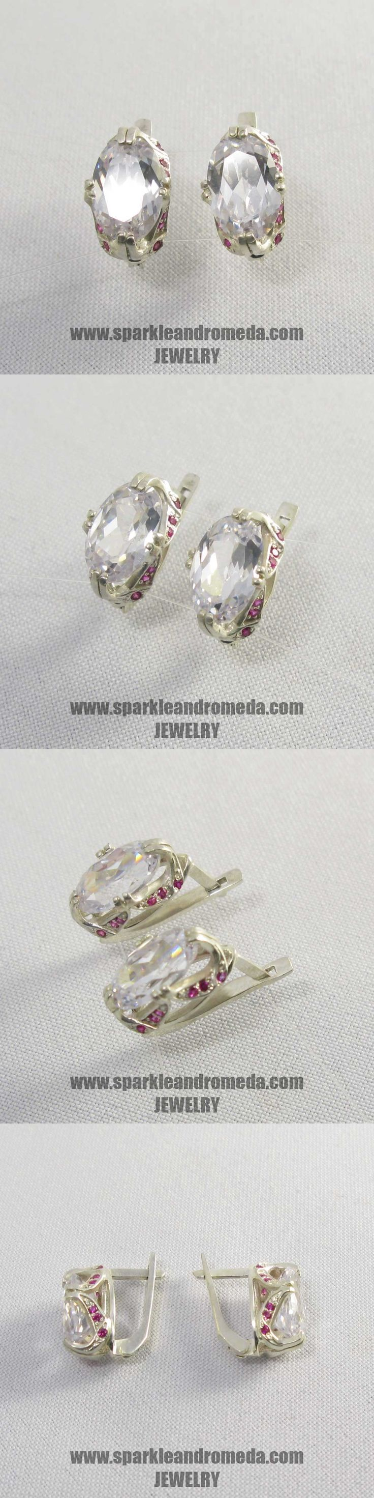 Sterling 925 silver earrings with 2 oval 12×8 mm white topaz color and 24 round 1,25 mm and 8 round 1 mm pink ruby color cubic zirconia gemstones.