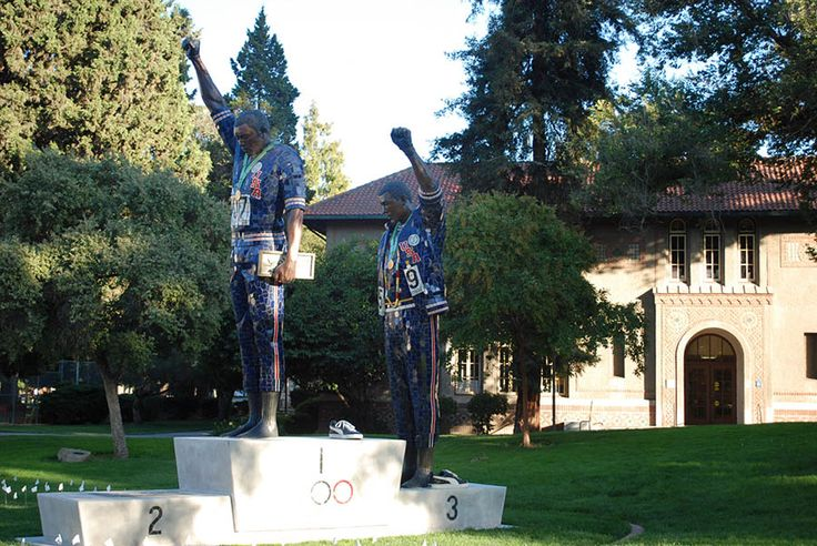 """I used to walk by the statue of those three men every day at SJSU, looking at the heroes John Carlos and Tommie Smith and never thinking about the story behind the third man Peter Norman's part in it until I came across this article: """"The White Man in That Photo"""" By Riccardo Gazzaniga www.filmsforaction.org/articles/the-white-man-in-that-photo"""