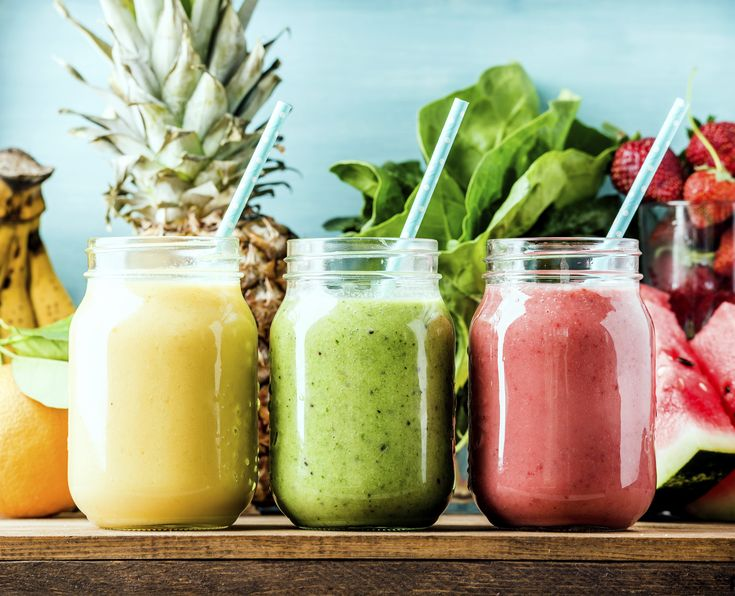 Fruit smoothies in reusable glass jars.