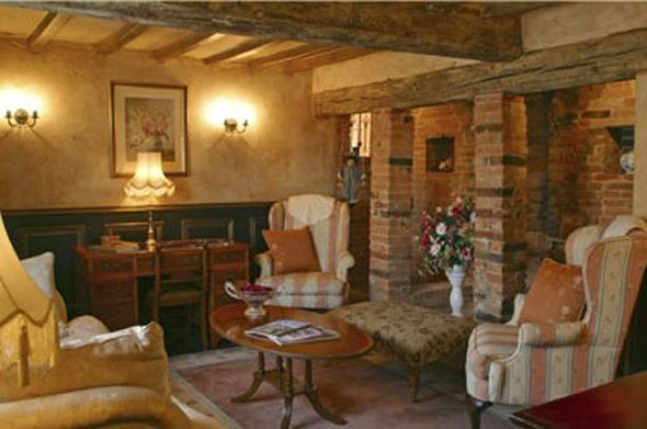 Old Fashioned Houses Inside Cozy Sitting Room With Rustic Wood Beams
