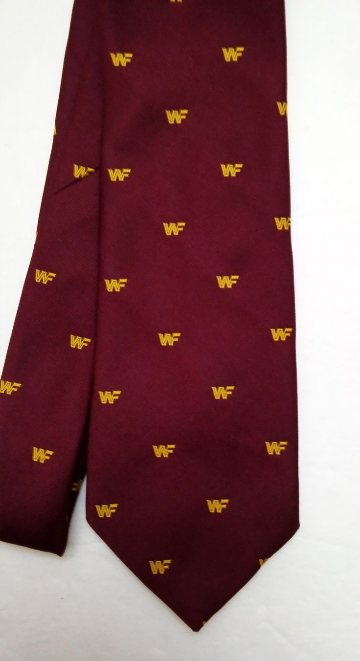 """Original 1982 Titan Sports!  Amazing!  Official WWF Logo Men's Neck Tie True Vintage: 1982  Burgundy Tie with Yellow Embroidered WWF Logos on both sides! High quality & heavy material Measures: 55"""" total length"""