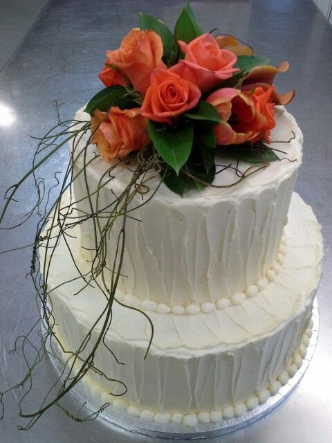 Rustic orange cream cheese pound 2 tier wedding cake at Blackbarn Winery Hawkes Bay, topped with orange fresh roses created by Belinda from Flowerlands n cakes baked n decorated by MJS Cakes Clive