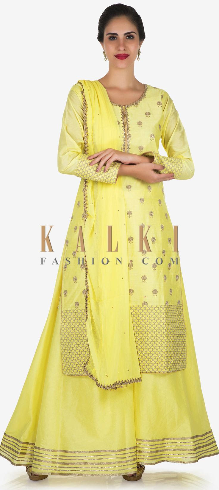 Buy Online from the link below. We ship worldwide Click Anywhere to Tag Light Yellow straight palazzo suit adorn in kundan neck and resham butti only on Kalki  Light yellow straight palazzo suit featuring in cotton. Neckline is highlighted in kundan embroidery along with resham embroidered butti all over. Matched with palazzo pant in silk with border in antique lace. The set is complete with chiffon dupatta in gold lace. Slight variation in color is possible