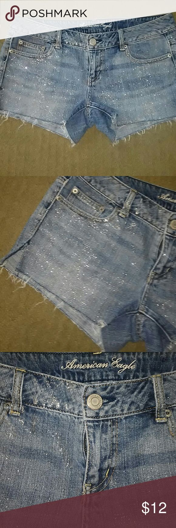 American Eagle Sparkle Shorts American Eagle cut off Sparkle shorts with a slit on the side great condition size 10 awesome pair of shorts American Eagle Outfitters Shorts Jean Shorts