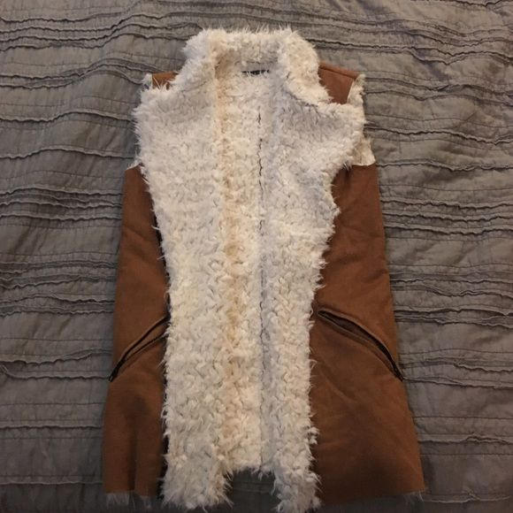 Brandy Melville vest Nwot suede vest . Tan and cream colored Brandy Melville Other