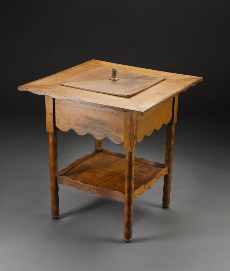 Square oak tea table with an inner compartment and central removeable lid with a turned handle and four rings, from the Ingram Street Tearooms in Glasgow, designed by Charles Rennie Mackintosh and probably made by John Craig, Glasgow, 1909, for either the Oval Room or the Ladies' Rest Room