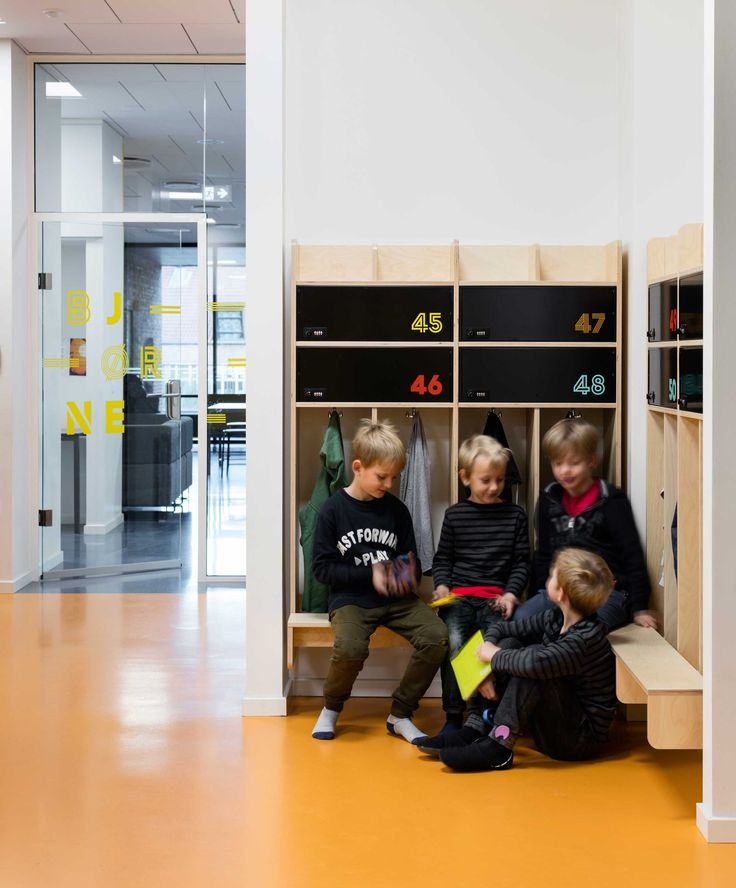 Signage and wayfinding at Frederiksbjerg School, Aarhus. The decoration helps break down large surfaces and makes the school appear more human-scaled. Further, we avoid traditional signs and other alien elements.