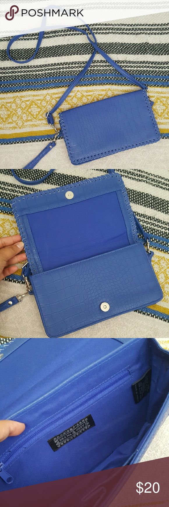 Urban Outfitters Deena & Ozzy blue clutch/wristlet Urban Outfitters Deena & Ozzy cobalt blue clutch/wristlet. Comes with detachable crossbody and wristlet straps. Excellent condition. Only used on one occasion. No trades. If you BUNDLE 3 items, you get 15% off! Urban Outfitters Bags Clutches & Wristlets