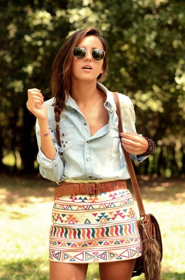 Chambray shirt tucked into tribal print high-waisted, belted mini.