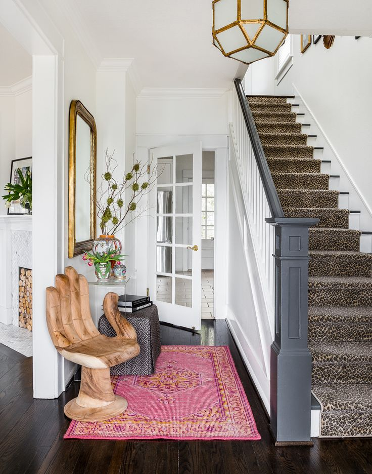 Eclectic Glamour in Seattle | Jenny Taylor of August Taylor Design helps a newly engaged couple create the home of their dreams | Photo by Haris Kenjar | Entryway Inspiration | Glamorous Entryway | Eclectic Entryway | Glamorous Entry | Eclectic Entry Decor | Leopard Stair Runner | Leopard Home Decor | Leopard print stair runner | Leopard print home decor | Glamorous Staircase | Staircase Inspiration | Staircase Runner Ideas |  Hand Chair | Entry Inspiration | Entry Decor Ideas Gold…