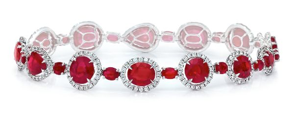 Ruby Bracelet  Ruby ovals, and pear-shapes are surrounded with brilliant micro-pavé diamonds, and linked with oval-shaped ruby connectors, in 18-karat white gold. Diamond weight: approximately 1.55 carats total; Ruby weight: approximately 17.59 carats total.