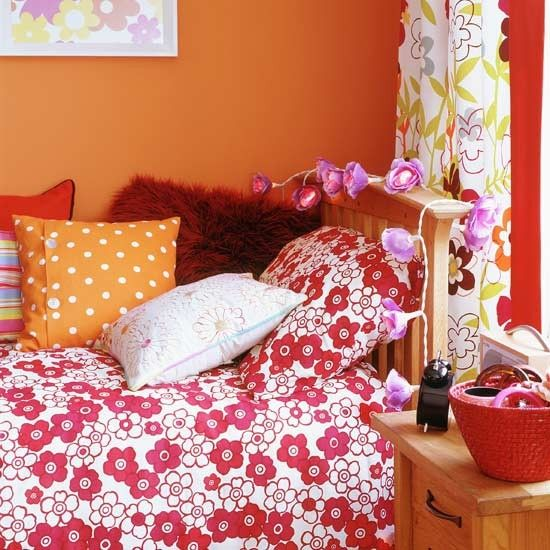 Girl Bedroom. Mesmerizing Endearing Girls Rooms Delightful Bedroom Design Ideas For Teenage Girl : Appealing Warm Orange Colour Teenage Girl Bedroom Ideas With Puffy Pillow And Flower Pattern Bedroom Furniture Design ~ wegli