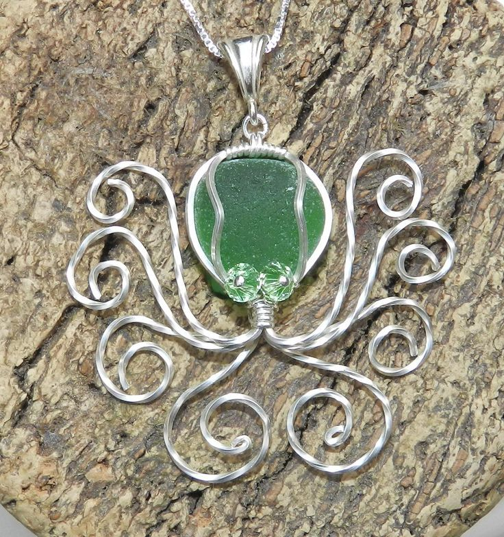 Octopus pendant with green sea glass and swarvoski crystals
