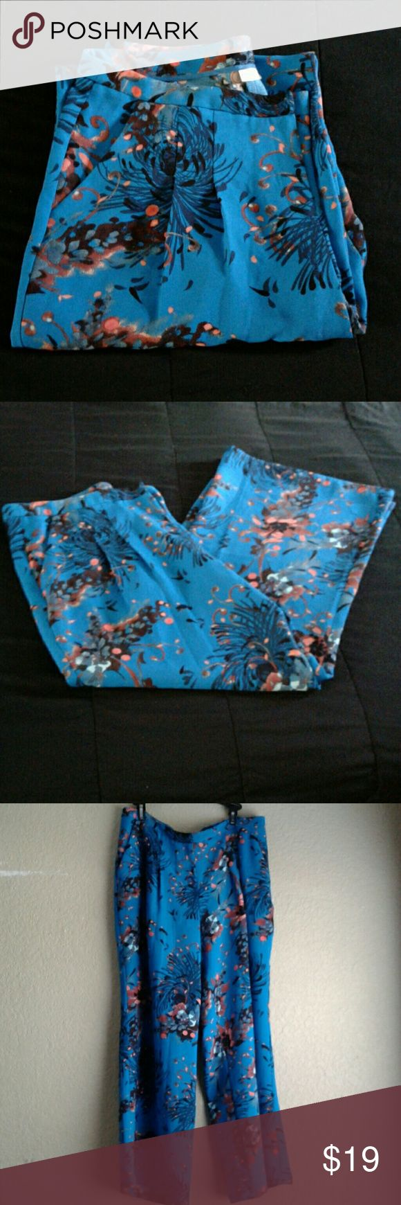 EVA MENDES NY & CO. PANTS Turquoise pants with bold colors petal design made by Eva Mendes. Great Condition wore once New York & Company Pants Trousers