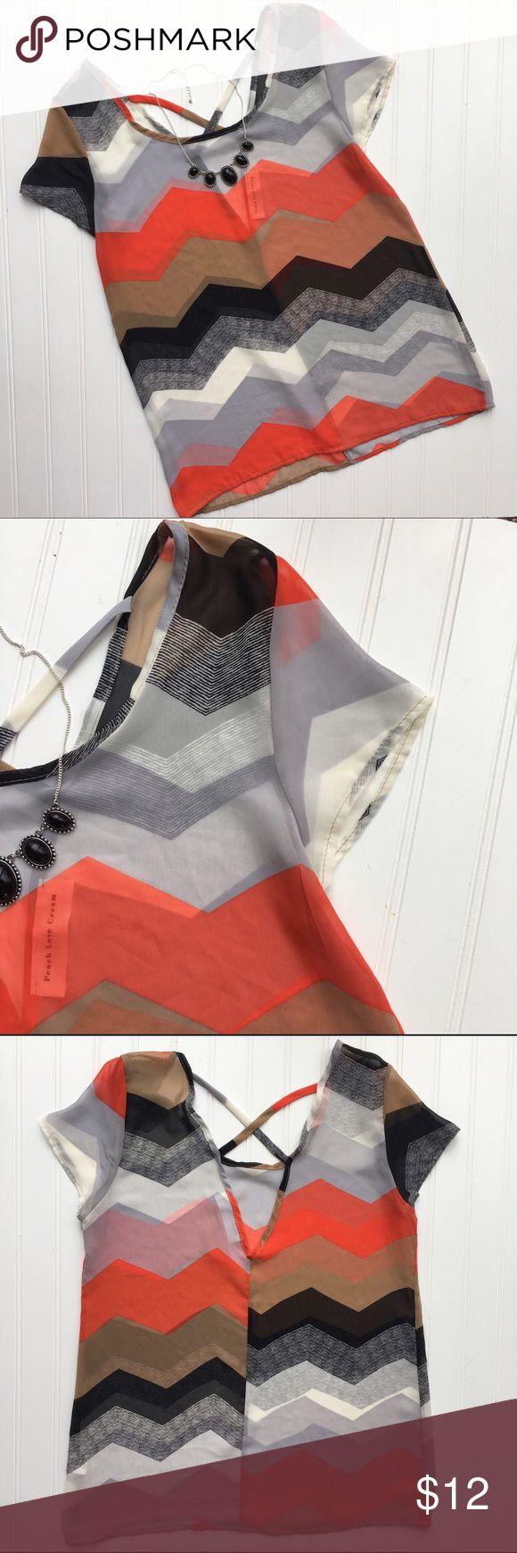 "Gorgeous sheer chevron blouse! Small Gorgeous orange, tan, black, and cream chevron print blouse! Sheer, and the back has a deep V with criss cross laces. So cute! Polyester. Peach Love Cream // Small // B 18"" L 26""// peach love cream Tops"