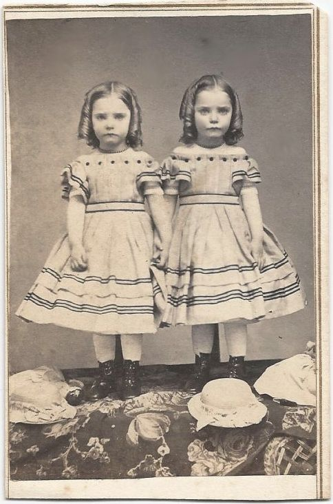 1860's twin girls with matching off-the shoulder dresses, necklaces, and ringlets.  Such an endearing picture.