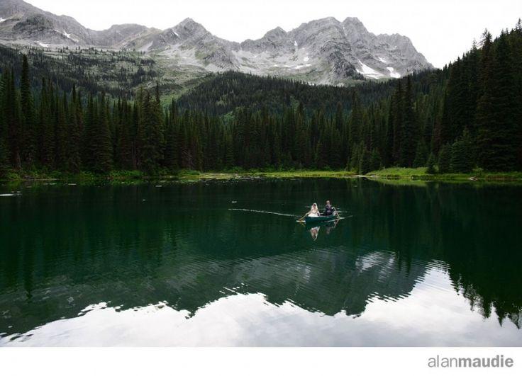 Bride and Groom in a canoe, Island Lake Lodge, Fernie Wedding Photographer, Canadian Rockies Wedding