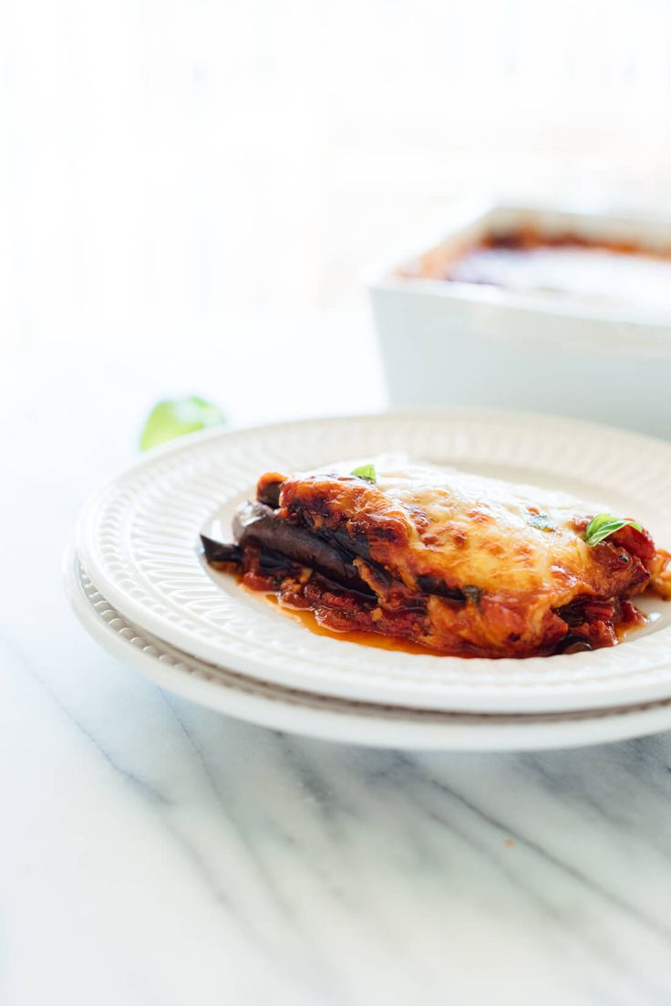 This Italian eggplant Parmesan recipe is lighter than most—it's made with roasted eggplant slices (not fried) and no breading (you won't miss it). #vegetarian