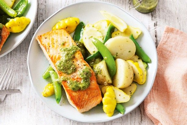 This crispy skinned salmon is served with vegetables and salsa verde for a complete family meal.