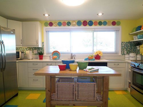 I have a TON of fiesta cups and saucers that we have no cabinet space for.  I love the idea of hanging the saucers over the windows in my kitchen!