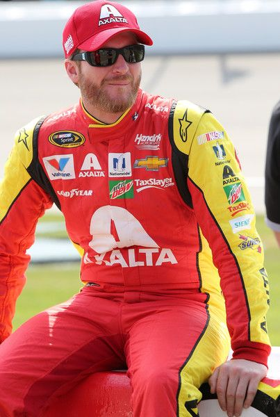 Dale Earnhardt Jr. Photos - Dale Earnhardt Jr, driver of the #88 Axalta Chevrolet, stands on the grid during qualifying for the NASCAR Sprint Cup Series FireKeepers Casino 400 at Michigan International Speedway on June 10, 2016 in Brooklyn, Michigan. - Michigan International Speedway - Day 1