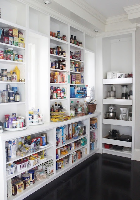 The most awesome kitchen pantry. It is a walk-in pantry. All white! Appliance shelves are actually roll-out drawers... :O