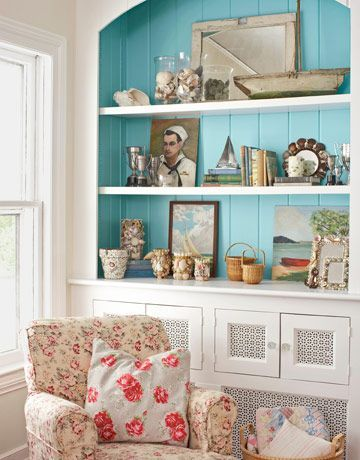 Painting the background of these shelves blue was so genius. It is so crisp and fresh looking.