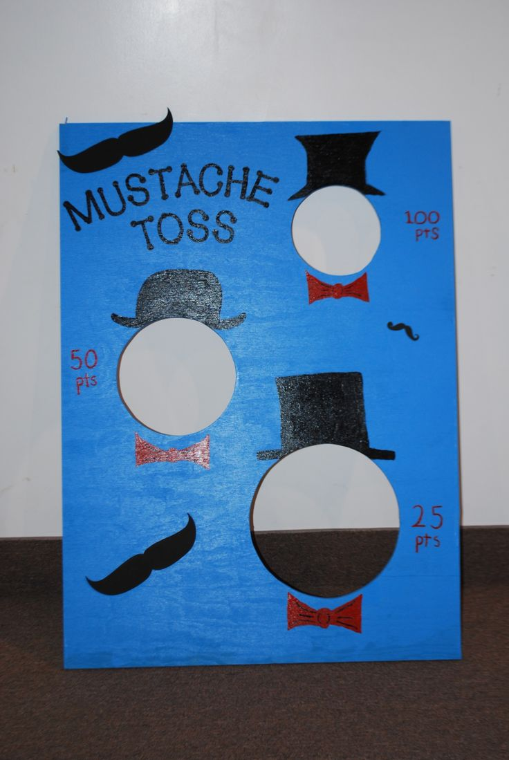 Mustache toss! My husband cut circles out of the wood. I painted it to match the colors of the party. Kids played the game and took pictures in it