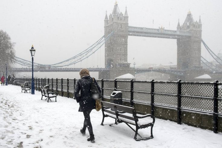 People walk in the snow past Tower Bridge, Central London, Britain, 28 February 2018. Heavy snow fall and sub-zero temperatures have hit Britain with more heavy snow expected in the coming days. Media reports state that extreme cold weather is forecast to hit many parts of Europe with temperatures plummeting to a possible ten year low. EPA/WILL OLIVER