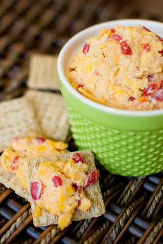 Pimento Cheese, My Way  Pink Parsley Original        * 8oz. extra sharp cheddar, shredded      * 4 oz. diced pimientos      * 2 Tbs Greek yogurt      * 2 Tbs mayonnaise (light is fine)      * 1/4-1/2 tsp crushed red pepper flakes      * 1/2 tsp Worcestershire sauce      * 1/8 tsp chili powder      * squeeze of lemon juice      * salt and pepper to taste