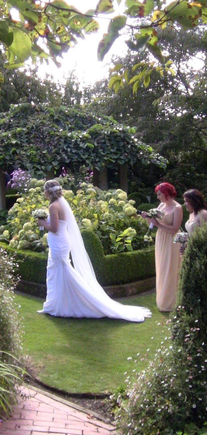 Bride making her way to her groom at Parkside Gardens Oamaru New Zealand