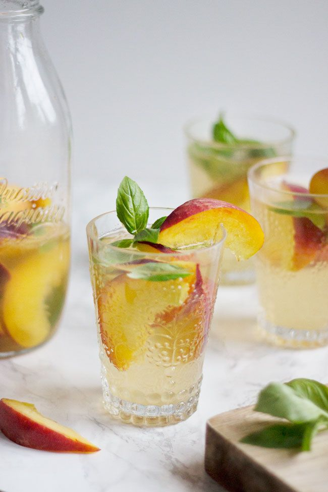 The Perfect Summer Cocktail: Peach Basil Kombucha Sangria | http://helloglow.co/peach-kombucha-sangria/