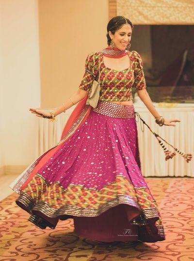 Mehendi Outfits - Purple Lehenga with an Ikat Choli | WedMeGood |Twirling bride in Mehendi Outfit with an Ikat Blouse and Purple Lehenga with Ikat Border #wedmegood #indianbride #indianwedding #mehendioutfit #mehendi #purple #twirlingbride
