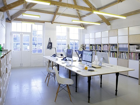 office design firm. the new office of londonbased graphic design firm apfel is simple and clean d