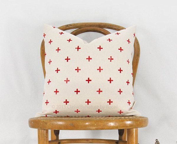 Beautiful Fabric Patten In Pillows Design : Awesome Pillow Among A Red Cross Motif Near Simple Wooden Chair Near White Wall