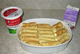 Nalysnyky are a rolled pancake or crepestuffed with a cottage cheese mixture and baked in bubbling sweet whipping cream. These have to be m...